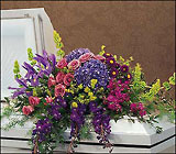 Graceful Tribute Casket Spray from Roses and More Florist in Dallas, TX